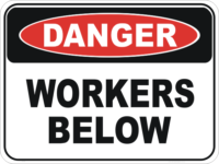 Workers below sign