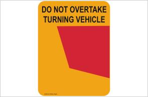 do not overtake turning vehicle