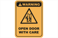 Open door with care warning sign