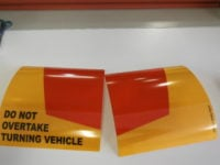 do not overtake turning vehicle signs