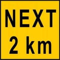 Next 2KM Sign