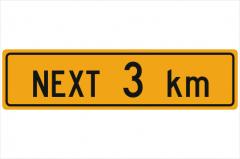 Next 3km sign