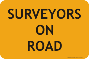 Surveyors on road sign