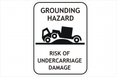Truck grounding hazard sign