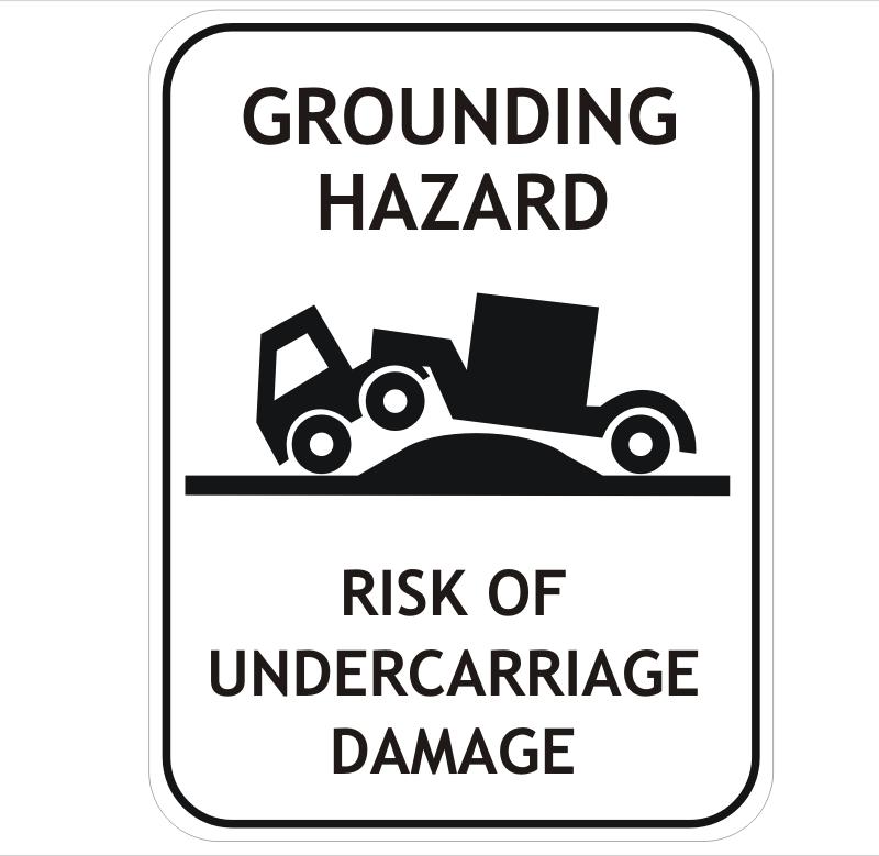 Truck grounding hazard sign