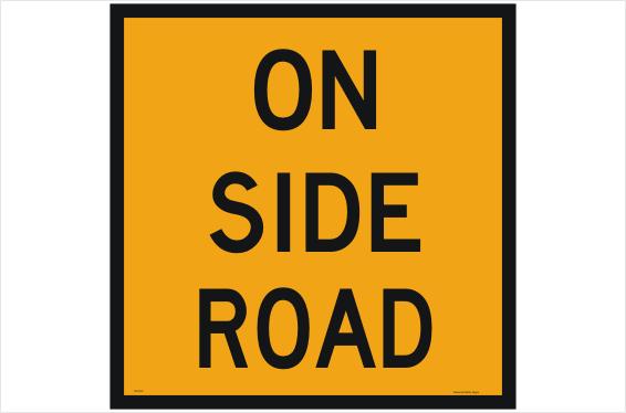 Roadworks on side road sign