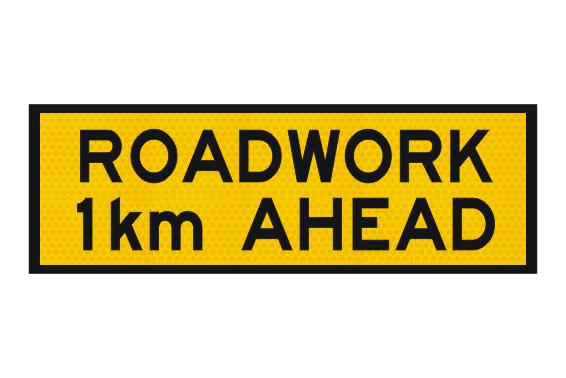 T1-16 Roadwork 1km ahead sign