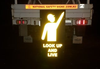 National Safety Signs pointing man